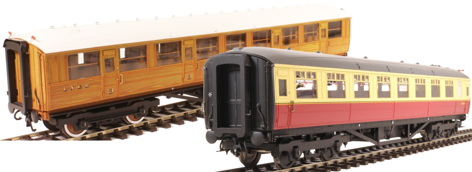 A group photo of three Hattons LNER teak coaches in BR carmine & cream and BR maroon liveries